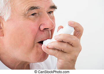 Man Using Asthma Inhaler - Close-up Of A Man Using Asthma...