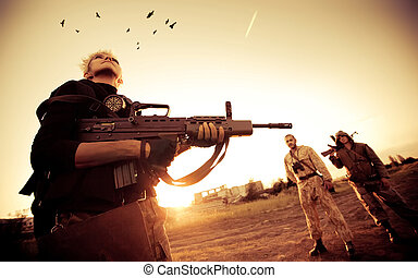 Military patrol - Blond woman with rifle is looking at...