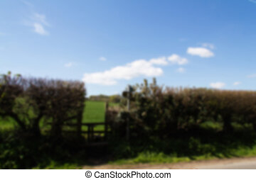 Wooden country stile in a hedge leading to field Out of...