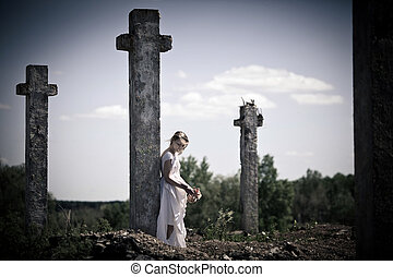 Sad girl near the cross
