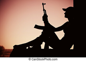 Girl with the Kalashnikov - Silhouette of a girl with the...