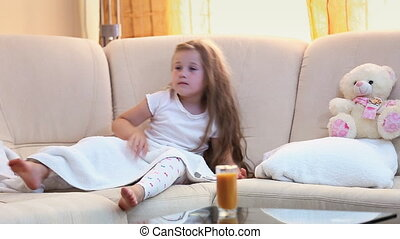Little girl drinks juice - little girl drinking orange juice