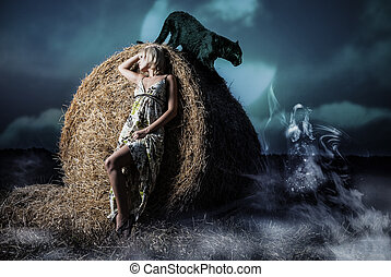young woman and night fiels hay - young woman standing at...