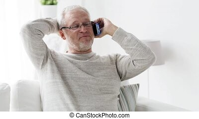 happy senior man calling on smartphone at home 99 -...