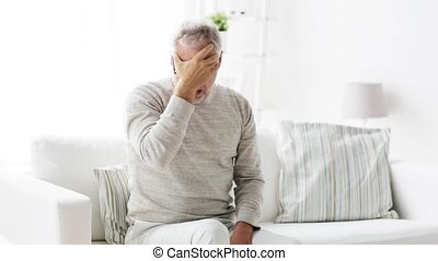 senior man suffering from headache at home 105 - health...