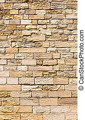 Eroded sandstone block wall