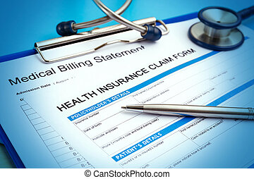 Health insurance claim form with medical bills and pen