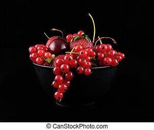 fresh red  fruit on black background