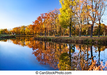 Landscape of river and trees in sunny day - View on autumn...