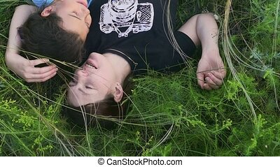 in a meadow lie daughter with her mother slow motion video