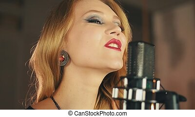 Portrait of vocalist with red lips make up perform at...