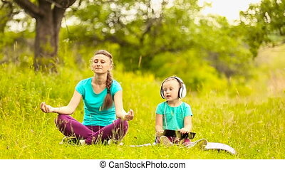 Mom and daughter eats meditate on nature