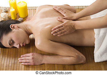 massage at spa with oil - cute woman laying down on wood...