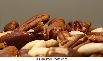 Mixed nuts rotating close up - Mixed nuts pile rotating in...