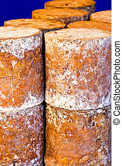 Stilton cheese - Pile of big matured Stilton cheese blocks