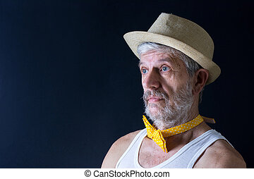 Crazy senior man with a hat and bow tie