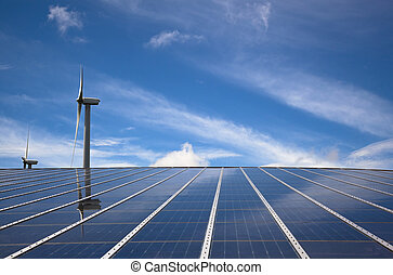 windmill and solar panel with cloud sky