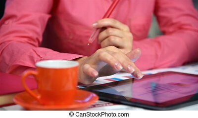 Woman Using Touch Pad And Analysis Of Annual Report Close Up...