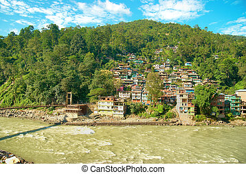 Houses in a town on river. India, Sikkim, Gangtok