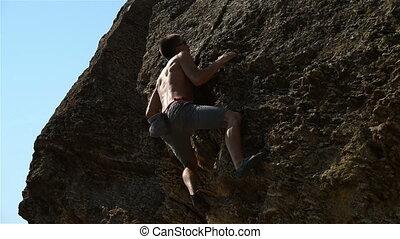 Climber Climbing On A Rock - Young Extreme Climber Climbing...