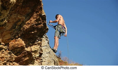 Climber Descends A Rope - Extreme Climber Descends A Rope...
