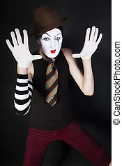Funny mime on a black background