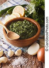 Argentine chimichurri sauce with ingredients close-up....