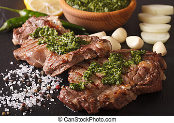 Argentine cuisine: grilled beef steak with chimichurri sauce...