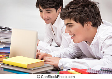 Happy schoolboys studying, two smart friends searching...
