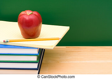 School Days - Stack of books with an apple in front of the...