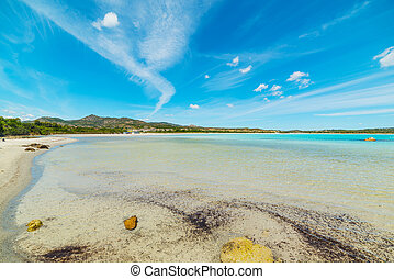 clouds over Lu Impostu - Lu Impostu beach under a blue sky,...