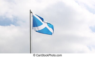Textile flag of Scotland on a flagpole - National flag of...