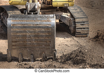 Tractor Excavating - A Tractor Excavating at a Construction...
