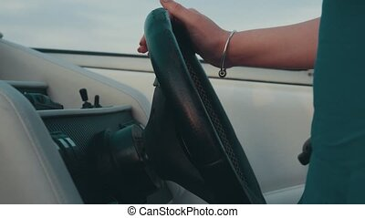 Girl drive motor boat Hands on steering wheel Summer evening...