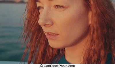 Portrait of red hair girl sail on motor boat Beautiful...