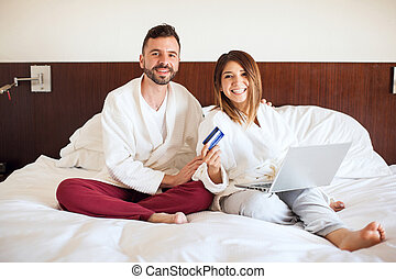Hispanic couple doing some online shopping - Portrait of a...