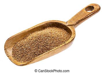 rustic scoop of teff grain