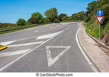 give way sign on asphalt on a country road