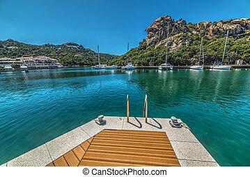 pier in Poltu Quatu harbor, Sardinia