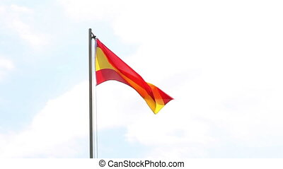 Textile flag of Spain on a flagpole