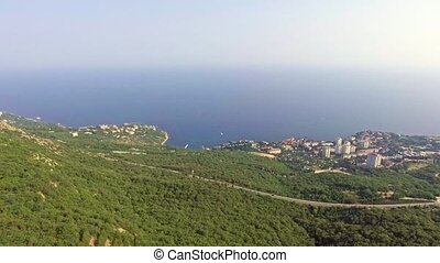 Aerial view with the city, sea, mountains and forest Shoot...