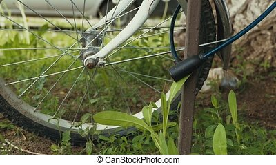 bicycle wheel to buckle up on the lock slow motion video -...