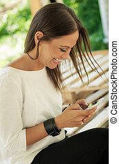 Happy woman using mobile phone - Happy young woman using...