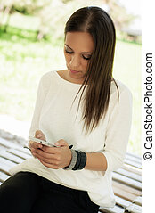 Woman using mobile phone - Young woman using cell phone