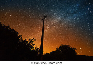 Electric pole under the milky way in Sardinia, Italy