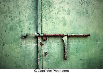 rusty metal deadbolt close up - close up of a rusty metal...