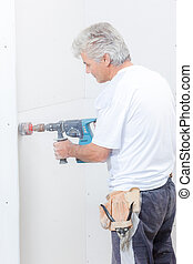 Builder using drill with attachment