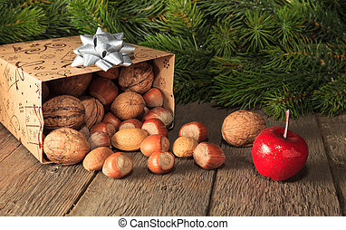 X-Mas Arrangement - Fruits falling from gift box on wooden...