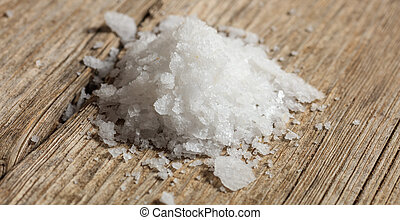 White salt on a wooden table