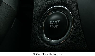 Engine start stop button from a modern car interior -...